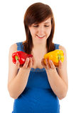 The woman has red and yellow pepper in her hands Stock Photo