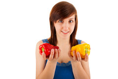 The woman has red and yellow pepper in her hands Stock Images