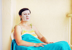 Woman has a rest with a cosmetic mask Stock Images