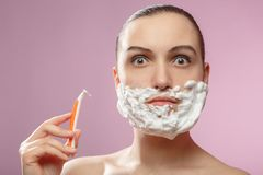 Woman has shave stock image