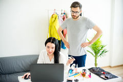 Woman has a shopping addiction. Woman is overspending money online and her frustrated husband telling her that Stock Photos