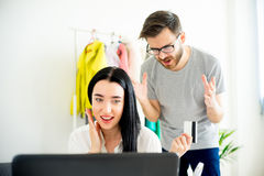 Woman has a shopping addiction. Woman is overspending money online and her frustrated husband telling her that Stock Images