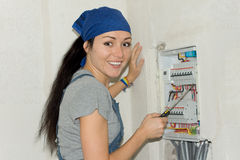 Woman has solved the fuse problem Royalty Free Stock Images