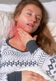 Woman has sore throat. Flu and fever Royalty Free Stock Photography