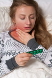 Woman has sore throat. Flu and fever Royalty Free Stock Image