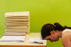 Woman has stress because of huge work on her desk stock images
