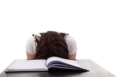 Woman has stress because of  work on her desk. Isolated on white background Royalty Free Stock Photography