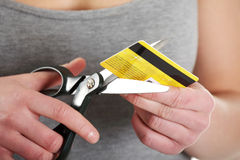 Woman has to destroy her credit card Royalty Free Stock Photo