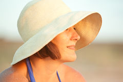 Woman with hat on Royalty Free Stock Photography