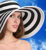 Woman in hat. Pretty woman in striped hat Royalty Free Stock Photography