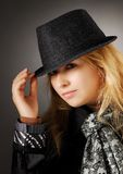 Woman in the hat. Woman in a hat on a black background Royalty Free Stock Photography