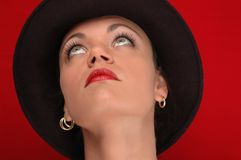Woman in hat. Woman in hat - red backgroung Stock Photo