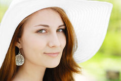Woman in a hat Stock Images