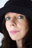Woman with hat. Middle-age woman portrait with black hat on stock photo
