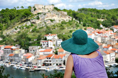 Woman with hat admiring cityscape. Novigrad, Croatia Royalty Free Stock Images