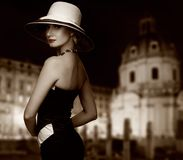 Woman in hat against night city view Royalty Free Stock Photos