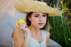Woman in hat with apple royalty free stock images