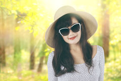 Woman with hat at autumn forest Royalty Free Stock Image
