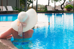 Woman  with hat  from back in  swimming pool Stock Image