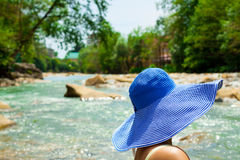 woman in hat on the background of the river Royalty Free Stock Photo