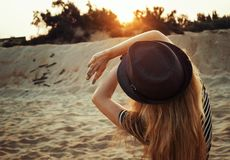 Woman with hat on beach Royalty Free Stock Image