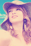 Woman with hat at the beach-color filters. Beautiful young blond woman with large straw sun hat - color filters Stock Photos