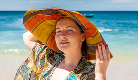 Woman in hat on the beach Stock Images