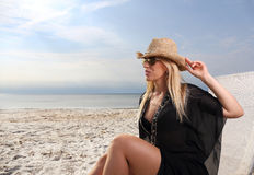 Woman with hat on the beach Stock Photo