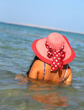 Woman in hat on beach Royalty Free Stock Photos