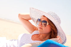 Woman in a hat on the beach Stock Photos