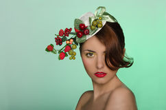 Woman in hat with berry decoration Royalty Free Stock Photos
