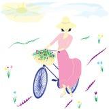 Woman in a hat bike basket flower field sun clouds light background. Woman in a hat bike basket flower field sun clouds Stock Photo