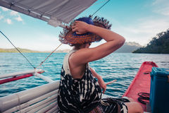 Woman with hat on boat Stock Images
