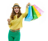 Woman in hat and bright clothes with shopping bags rejoicing Royalty Free Stock Photo