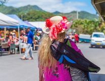 Woman in a hat on a city street, Rarotonga, Aitutaki, Cook Islands. With selective focus. Back view royalty free stock photos