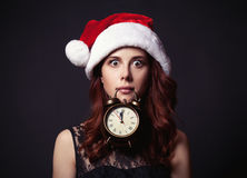 Woman in hat with clock Stock Photos