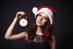 Woman in hat with clock Royalty Free Stock Photo