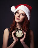 Woman in hat with clock Stock Photo
