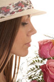 Woman hat close smell roses Royalty Free Stock Image