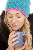 Woman hat coat mug eyes closed Royalty Free Stock Photo