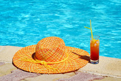 Woman hat with cocktail near swimming pool Stock Photography