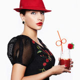 Woman in Hat drink cocktail Royalty Free Stock Photography