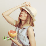 Woman in hat drinking grapefruit juice. Diet Royalty Free Stock Images
