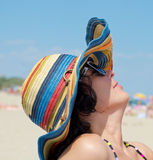 Woman with hat enjoying on beach Stock Images