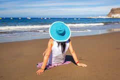 Woman in hat enjoying sun holidays on the beach Stock Images
