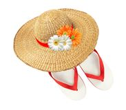 Woman hat with flowers and flip flops isolated on white Stock Photos
