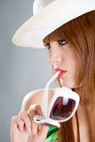 Woman in hat with glass portrait Royalty Free Stock Photo