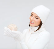 Woman in hat and gloves with christmas ball Royalty Free Stock Photo