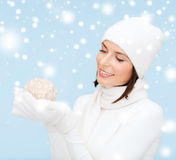 Woman in hat and gloves with christmas ball Royalty Free Stock Images