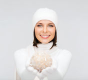Woman in hat and gloves with christmas ball Stock Images